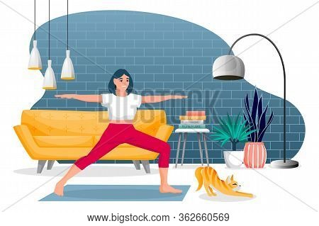 Girl Stands In A Warrior Pose Virabhadrasana. Home Yoga Exercise Practice. Woman And Red Cute Cat Tr