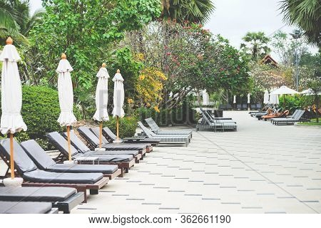 Deckchairs In The Resort Garden At Pattaya, Chonburi, Thailand.