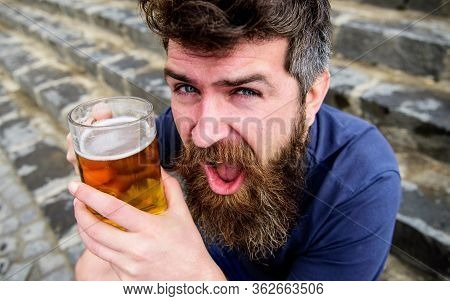 Friday Relax Concept. Guy Having Rest With Cold Draught Beer. Hipster On Cheerful Face Drinking Beer