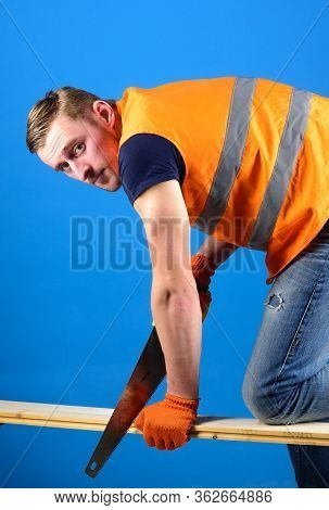 Carpenter, Woodworker, Labourer, Builder On Busy Face Sawing Wooden Beam Or Board. Woodcraft Concept