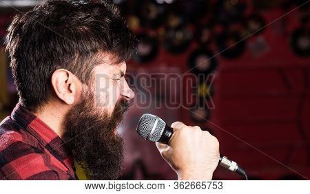 Musician With Beard And Mustache Singing Song In Karaoke. Punk Rock Concept. Guy Likes To Sing In Ag