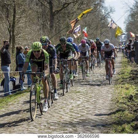 Wallers,france - April 12,2015: The Peloton Riding On A Cobblestone Road During The Paris Roubaix 20