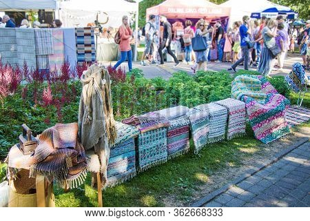 Riga, Latvia - July 8, 2018: Exhibition Sale Of Weave Rugs And Textiles At The Fair. All-latvian Son