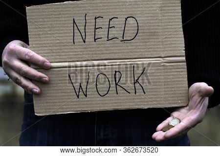The Unemployed Person Holds In His Hand The Cardboard Tablet With The Inscription Need Work In His O