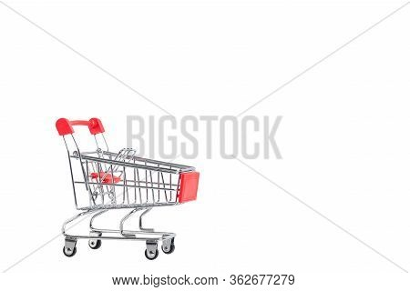 A Shopping Cart. Mini Shopping Trolley, Isolated On White Background. Mini Shopping Cart On The Tabl