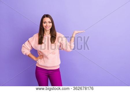 Photo Of Beautiful Business Lady Manager Toothy Beaming Smiling Holding Novelty Product On Open Arm