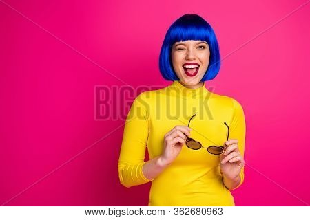 Photo Of Attractive Funny Lady Modern Look Beaming Smile Blink Eye Hold Retro Specs Wear Stylish Yel