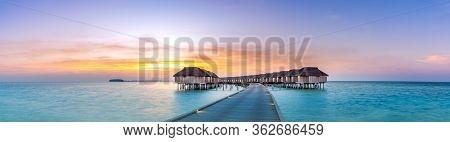 Maldives Island Sunset. Water Bungalows Resort With Long Jetty At Islands Beach. Indian Ocean, Maldi