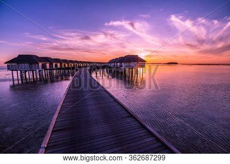 Maldives Island Sunset. Water Bungalows Resort At Islands Beach. Indian Ocean, Maldives. Sunset On M