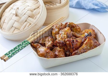 Asian Style Hot Chicken Wings Served On Bowl