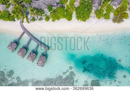 Perfect Aerial Landscape, Luxury Tropical Resort Or Hotel With Water Villas And Beautiful Beach Scen