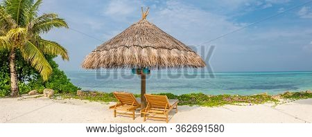 Vacation Holidays Background, Two Beach Lounge Chairs Under Tent On Beach. Wide Angle Panorama, Blue