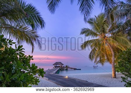 Maldives Resort Island In Sunset With Wooden Jetty, Amazing Colorful Sky. Perfect Sunset Beach Scene