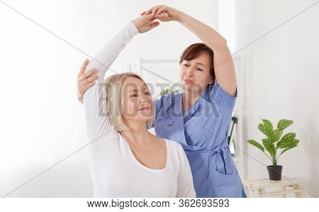 Physiotherapy, Sport Injury Rehabilitation Treatment. Woman Having Chiropractic Back Adjustment. Ost