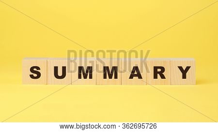 Summary Inscription On Wooden Blocks Isolated On Yellow Background Business Concept