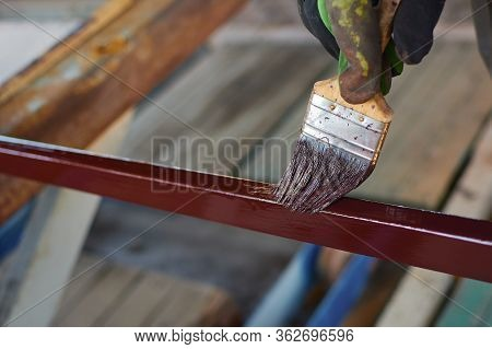 Metal Stub. Paint Brush. To Paint An Iron Pole To Paint With Brown Paint. Painting Process