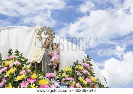 Religious Image Of The Virgin During The 'virgen Del Carmen' Procession