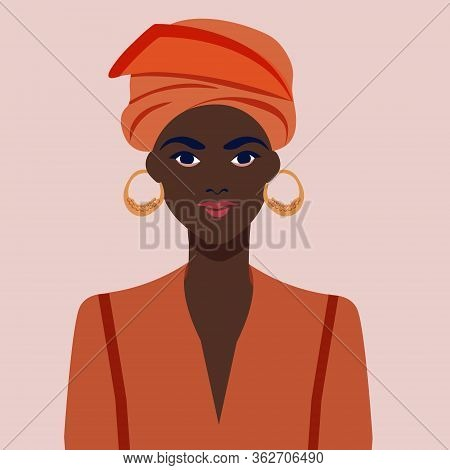 Portrait Of A Beautiful African Woman With Earring. Female Portrait. Black Beauty Concept.