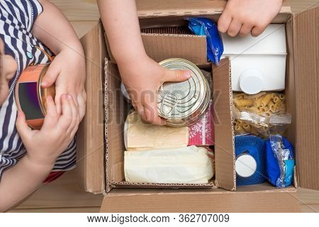 Delivery During Quarantine. Box With Merchandise, Goods And Food. Contactless Delivery. Assistance C