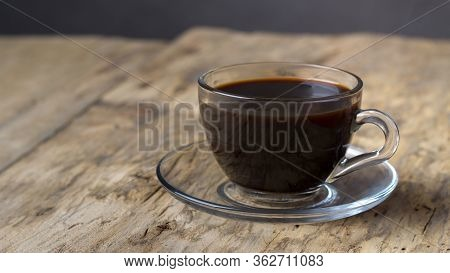 Coffee In A Transparent Glass Cup On A Wooden Table