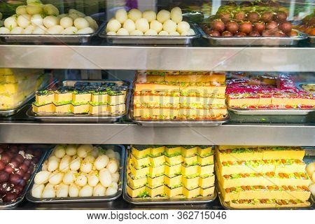 Many Delicious Traditional Indian Sweets And Desserts At Storefront At Asian Food Market