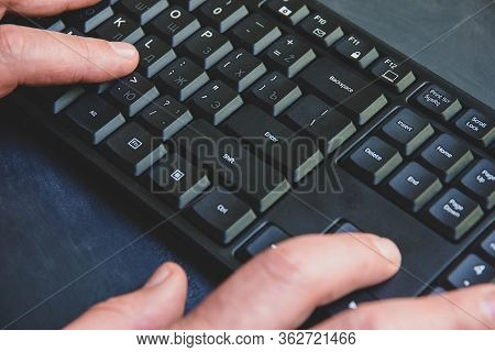 Close-up Of Typing Man's Hands On Black Keyboard. Hand Writing Something On The Computer Keyboard.