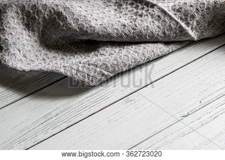 Gray Dishcloth On A Gray Wooden Table In The Kitchen. Kitchen Cloth.
