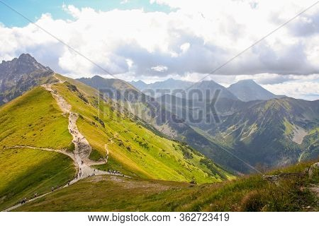Mountain Panorama View On The Top Of A Kasprowy Wierch Mount In Tatry, Poland. Mountain Ragne Landsc