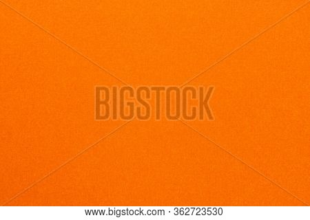 High Resolution Close Up Of Bright Orange Felt Fabric Texture Of Rough Fleecy Fabric Of Orange Color