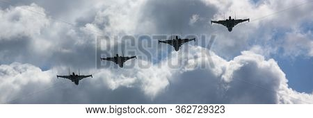 Group Of Military Aircrafts Flying In Blue Sky. Fast Warplane Jets Designed For Attacking Other Arme