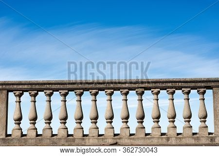 Closeup Of A Concrete Balustrade On A Blue Sky With Clouds And Copy Space