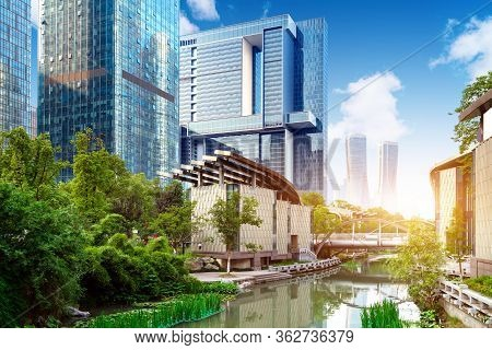Modern Buildings On Both Sides Of The Creek, Hangzhou, China.