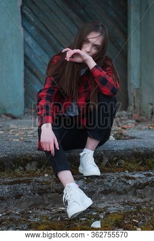 Lonely Sad Girl Sitting In An Abandoned Place, Cinematics Portrait,