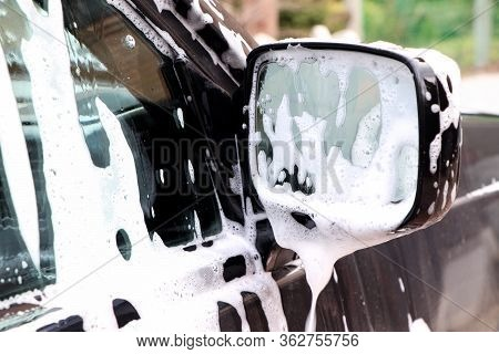 Washing A Car. Foam And Soap. Windows And Mirror Of A Car. Cleaning A Car.