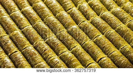 Traditional Turkish Baklava With Roll-shaped Pistachio. Sweet, Bright Background, Banner.
