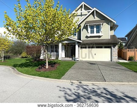 Beautiful new house in spring time, on a quiet cul-de-sac in British Columbia, Canada.