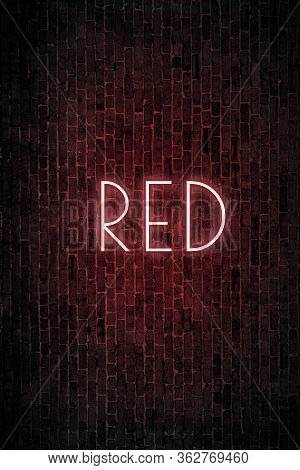 Red - Neon Text Illuminated In The Dark On A Bricks Wall