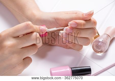 Manicure. A Woman Paints Her Nails. The Girl Applies Nail Polish. French, Nail Care. Nail Salon, Pro