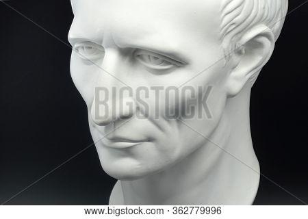 Julius Caesar Roman Emperor Gypsum Bust On Black Background