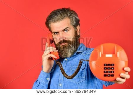 Mature Bearded Man Talk On Retro Phone. Vintage Technology In Modern Life. Young Man Talking On Tele
