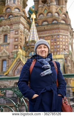 Woman On The Background Of The Savior On Blood In St. Petersburg.