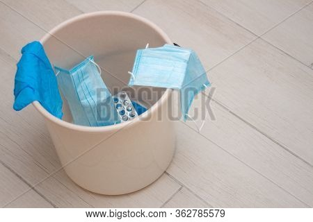 Used Blue Medical Latex Gloves And Disposable Protective Masks In The Bin. Problem Of The Disposal O