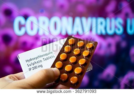Hydroxychloroquine Sulphate Tablets With Coronavirus Written In Background
