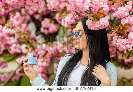 Natural Fragrant Essential Oils. Eau De Toilette. Luxury Fragrance. Fashionable Woman Hold Perfume B