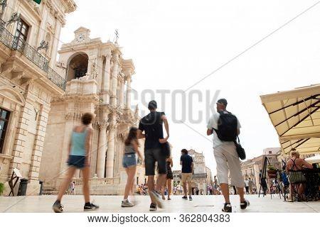 Syracuse (Siracusa) with crowd of people, Sicily, Italy. Cathedral of Syracuse with tourists (Duomo di Siracusa or the Cattedrale metropolitana della Nativita di Maria Santissima), Ortigia, Syracuse