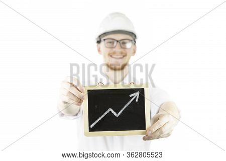 Cocky, Satisfied Businessman Builder Wearing White Helmet Holds Upward Trend Graph Smiling Looks At