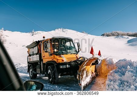 Zabljak, Montenegro - 02 January 2018: Snow-covered Mountain Track. Cleaning From Snow On The Road.
