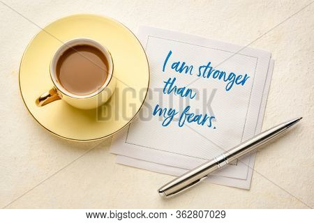 I am stronger than my fears - handwriting on a napkin with coffee. Positive affirmation and personal development concept.
