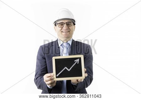 Cocky, Satisfied And Overconfident Handsome Constructor Oilman Wearing White Helmet Holds Upward Tre