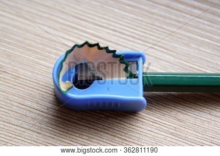 Sharpening Pencil. Wooden Pencil In A Sharpener. Sharpener And A Pencil.